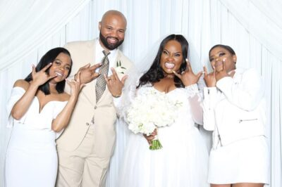 Tasha Cobbs, her husband and their kids