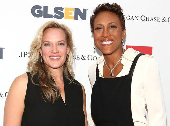 Robin Roberts (R) with her partner Amber Laign (L)