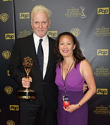 Anthony Geary holding his 8th Daytime Emmy next to General Hospital Online creator May Lee, April 26, 2015