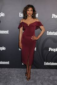 Sarayu Blue in an event wearing a maroon dress