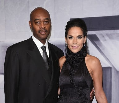 A photo of Citi group vice chairman, Raymond McGuire with his wife author/filmaker Crystal McCrary