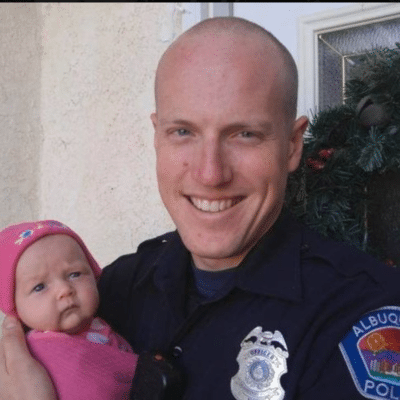 Officer Ryan Holets's photo with his adopted baby